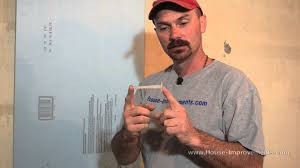 Insulating Basement Concrete Walls by How To Attach Rigid Foam Insulation To Concrete Youtube