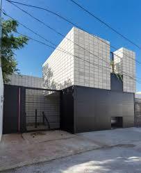 c shaped concrete block home wraps around swimming pool courtyard
