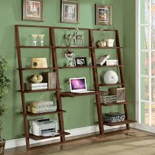 brown polished oak wood leaning and ladder shelves with computer