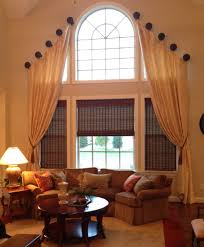 love this a two story living room requires a dramatic window