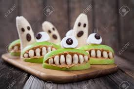 scary edible halloween treat apple cyclop mouth with peanut butter