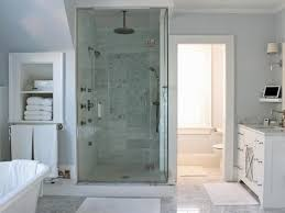 this soothing pale gray and white spa bathroom features a