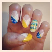 summery marine nail design by cameko nails wonder woman