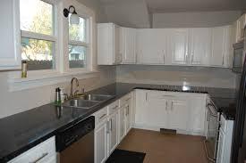 dark grey kitchen cabinets light gray with aqua also white cabinet