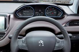 peugeot 2016 models peugeot interiors tiny steering wheels for all by car magazine