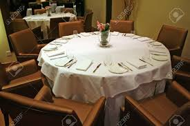 elegant restaurant dining table setting with cutlery stock photo