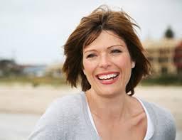 Older women dating younger men  the lowdown   EliteSingles Elite Singles Laughing older woman on the beach