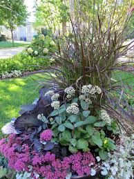 Fall Landscaping Ideas by Using Fall Plants Like Sedum Ornamental Cabbage And Purple