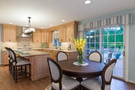 country kitchen with french doors and victorian wooden round