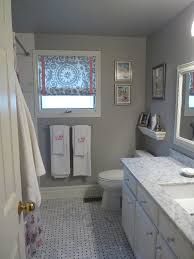 trendy white wooden vanity with white marble top added wall mirror
