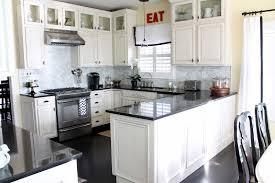 white kitchen cabinets with black granite edgarpoe net