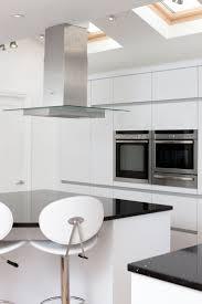 Handleless Kitchen Cabinets Keller Polygloss White Handleless Kitchen With Silestone Stellar