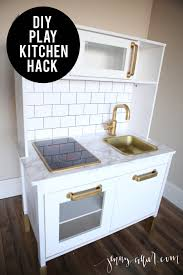 diy play kitchen hack for makaila pinterest faux marble probably the cutest play kitchen i have ever seen sharing a tutorial for a chic diy play kitchen hack featuring white cabinets a faux marble countertop
