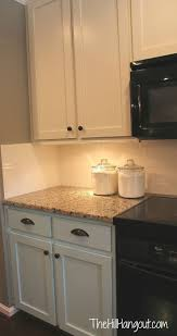 Painting Pressboard Kitchen Cabinets by Best 25 Tan Kitchen Cabinets Ideas On Pinterest Neutral