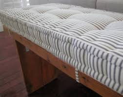 custom bench cushions shown in charcoal ticking stripe fabric