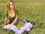 Emma Watson In Green Dress Sit On Ground Grass Beautiful Wallpaper