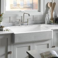 interior white fiberglass under mount sink combined granite top