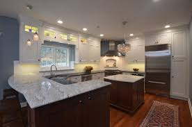 White Kitchen Cabinets With Black Granite Countertops by White Thunder Granite After Black Cambrian Granite White