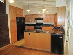 Maple Kitchen Cabinets Maple Kitchen Cabinets With Black Appliances Kitchen Go Review