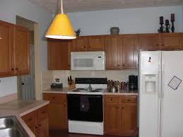 small kitchen decoration using white laminate cream kitchen
