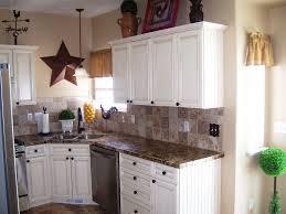 granite countertop white kitchen cabinets with black hardware