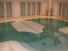 In Door Pool by Indoor Outdoor Automatic Energy Saving Pool Covers By Pool Cover