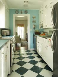 light blue kitchen and black and white floor patern checkerboard