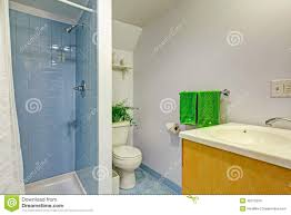 bathroom interior with light blue tile wall trim and blue tile