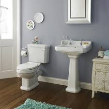 beadboard wainscoting bathroom with sink and toilet also cabinet