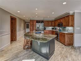 traditional kitchen with kitchen island u0026 raised panel in hilton