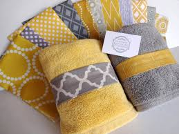 gray and yellow bath towels towel