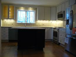 kitchen with wooden cabinets and using under cabinet lighting over