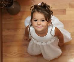 little girls adorable|Adorable little girl combed with pigtails sitting on floor