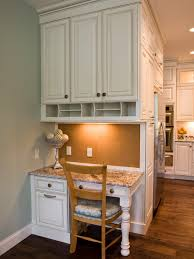 this custom designed kitchen desk area features plenty of storage