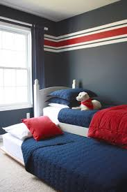 bedroom with striped wall and red cushion boyroom interior http