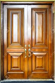 close up of heavy wooden door with simple design stock photo