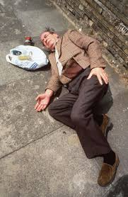 an elderly gentleman who has fallen in the street.