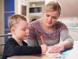 mom parent kid helping homework