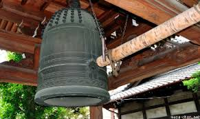 At midnight the temple bell tolls to ring in the new year  but also for