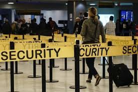 Passengers make their way in a security checkpoint at the International JFK airport in New York Yahoo News Singapore