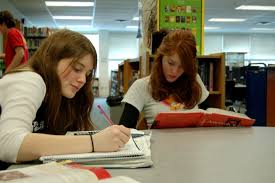 San Francisco Middle Schools No Longer Teaching      Algebra          The     KQED Two girls spend time at a library studying math and doing homework