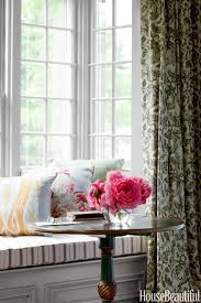 cape cod style house neutral decorating ideas striped window seat