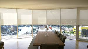 sunscreen roller blinds to floor to ceiling windows arranged in