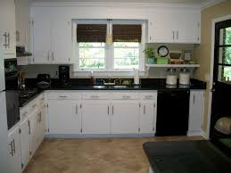 Ivory White Kitchen Cabinets by White Wooden Kitchen Cabinet With Black Counter Top Plus Glass