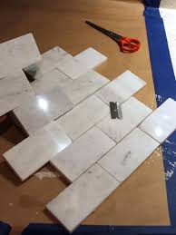 how to install a marble tile backsplash hgtv place individual tiles around outlets