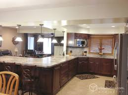 Kitchen Peninsula With Seating by This Traditional G Shaped Kitchen Features The Carlton Raised