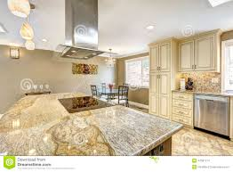 beautiful kitchen island with granite top built in stove and ho