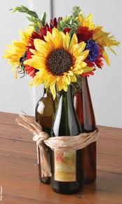 wine bottles used as 50th birthday party decorations see more