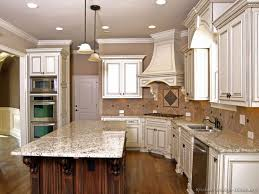 Off White Kitchen Cabinets With Black Countertops Granite Countertop White Kitchen Cabinets And Black Countertops