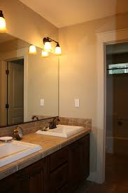 beige bathroom design idea feat awesome frameless mirror and